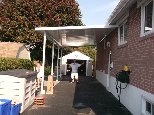 home owner thrilled with his new carport.