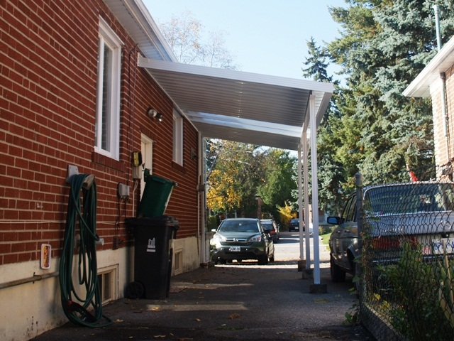 "carport with deep 'W' 12"" panels, installed with an optional two 24"" optional clear panels."