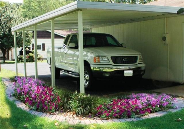 "shallow 'V' 10"" panel carport, mounted on a siding wall."