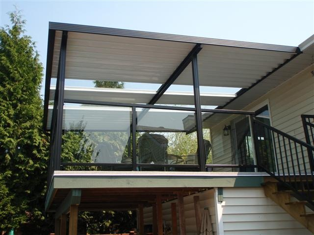 combination solid / clear patio cover using clear glass panels.