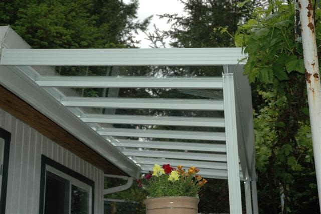 clear glass roof, white aluminum
