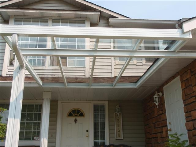 glass roof attached to side fascia.