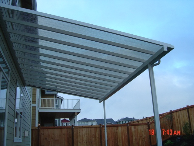 Polycarbonate canopy over open space.