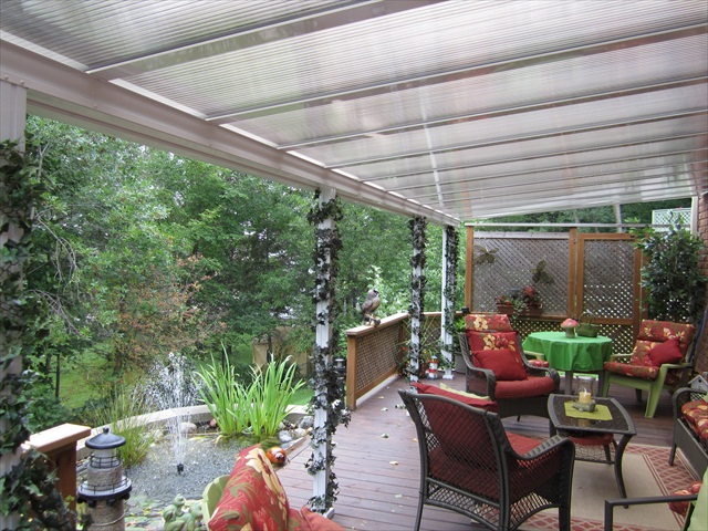 insulated polycarbonate canopy installed over an ope area.