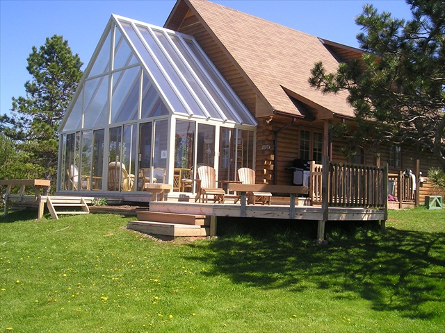 tall polycarbonate roof over a sunroom.