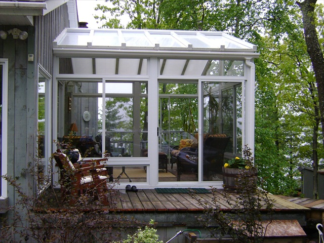 solarium with cathedral clear polycarbonate roof.