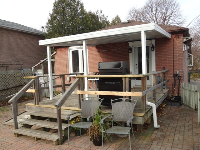 small patio cover installed under soffit.