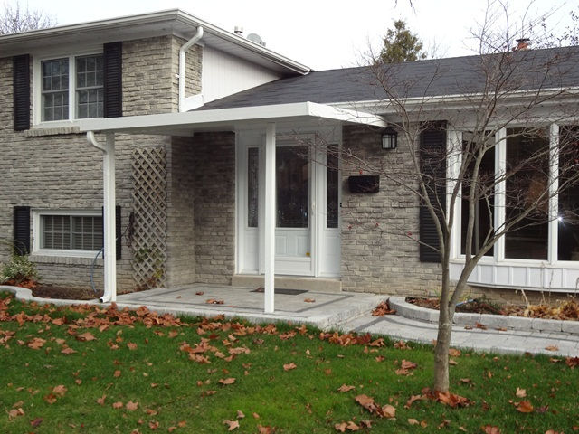 whiote aluminum patio cover nicely blend with house' appearance