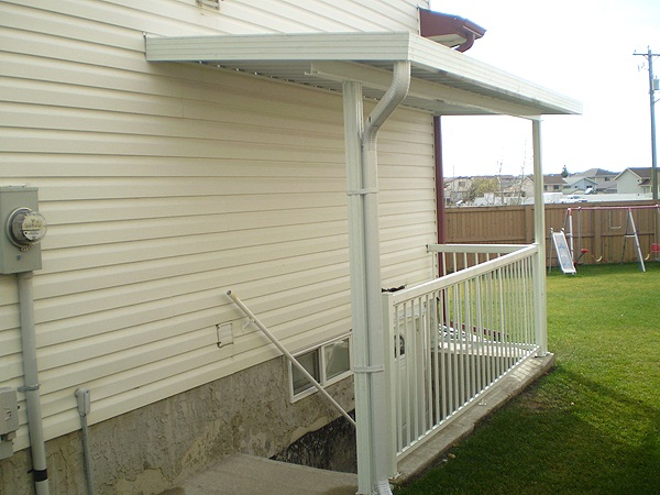 small side basement entrance canopy.