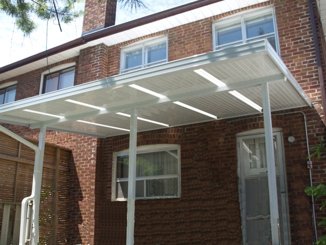 back porch covered with aluminum pan roof and skylites.