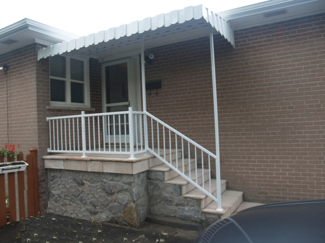 Side awning using railing posts as support.