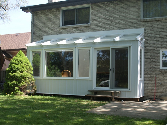 Conventionally built insulated sunroom with clear roof
