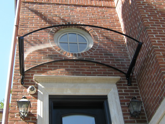 barrel awning with brace