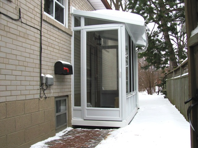 side door enclosure, used as a vestibule to a home office.